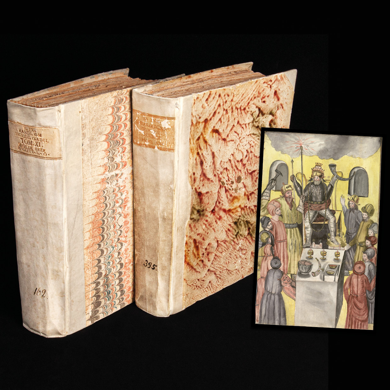 two volumes with marbled book paper, and a drawing of the norse gods standing around Oden in the middle