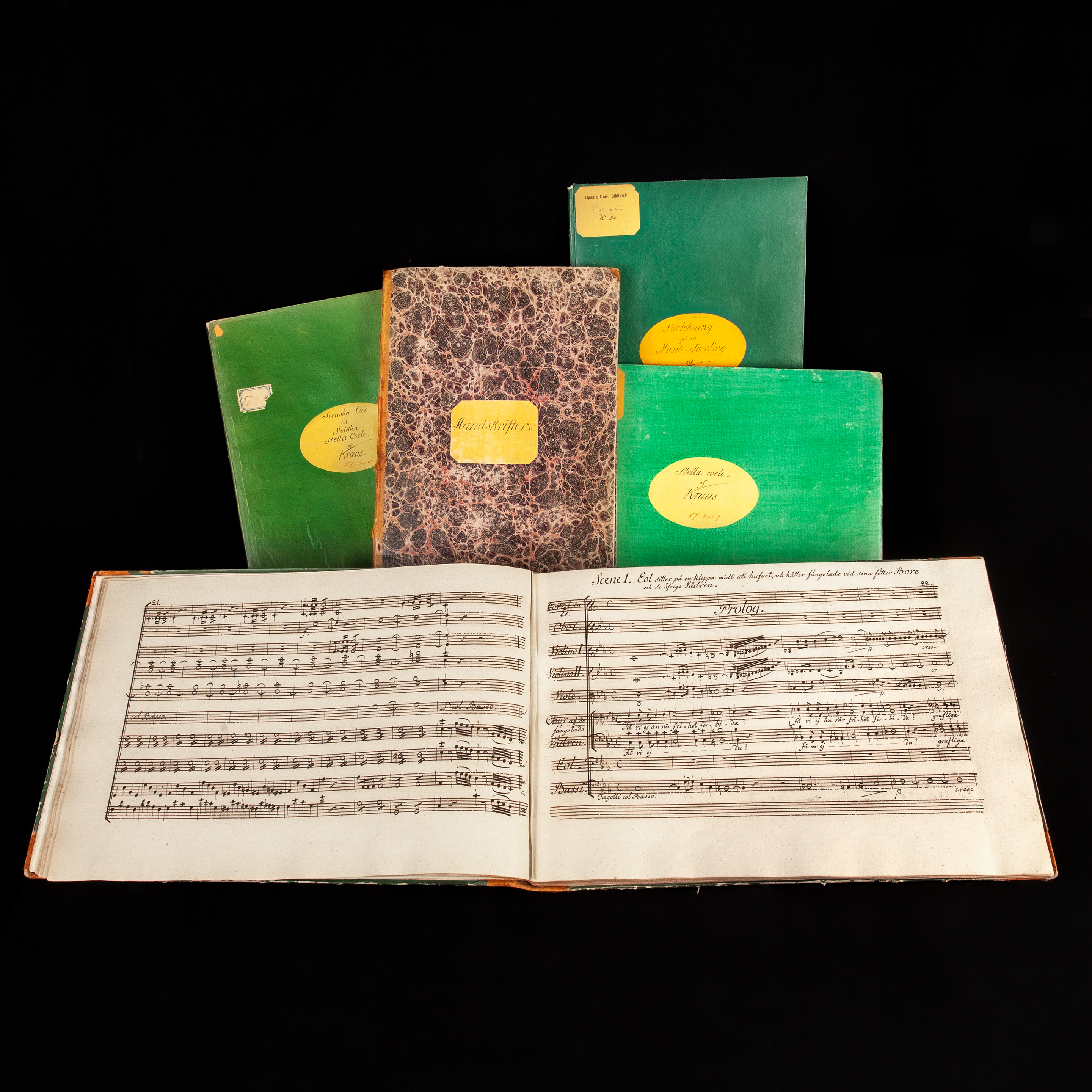 manuscripts and music scores in bright green or marbled bindings